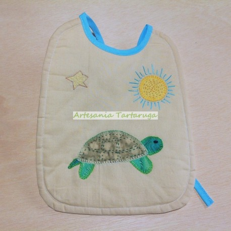 Large bib with patchwork applications