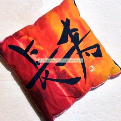 Orange cushion with asian letters