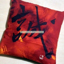 Red cushion with asian letters