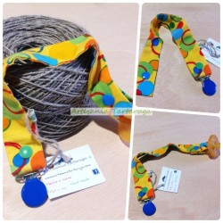 Handmade pacifier clip with yellow printed fabric