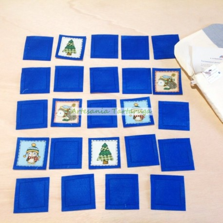 Portable memory made of blue felt and printed winter fabric