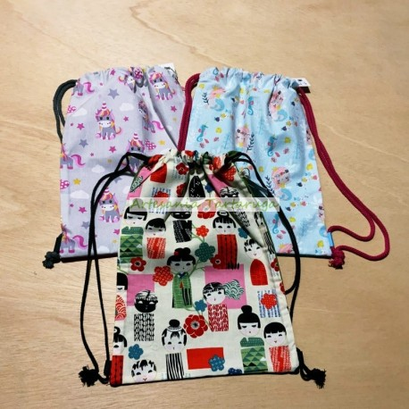 Schoolbags with kokeshis, mermaids,...