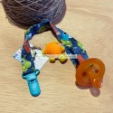 Handmade pacifier clip with monster print